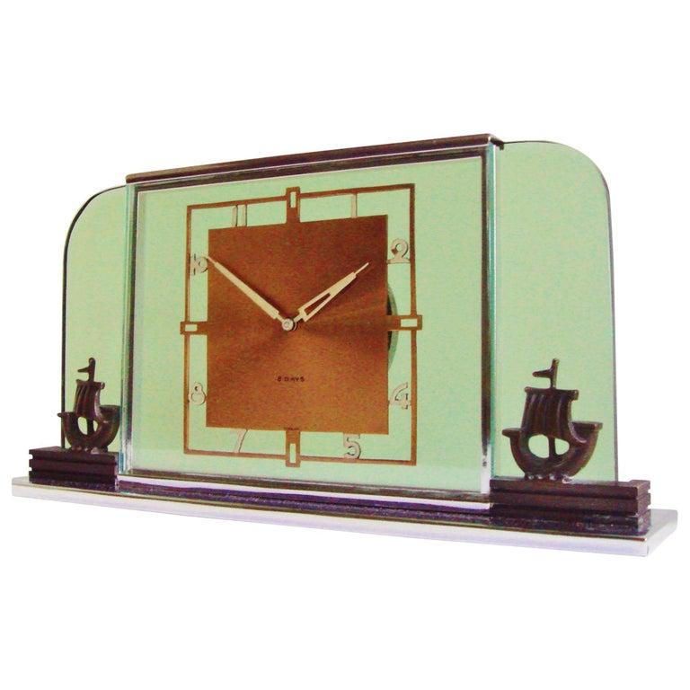 German Art Deco Glass, Chrome, Copper and Bronze Figural Mechanical Desk Clock For Sale