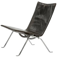 PK 22 Lounge Chair in Spring Steel and Black Leather