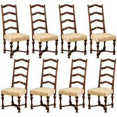 Set of Eight French Louis XIII Carved Walnut Ladder Back Chairs with Seat Fabric