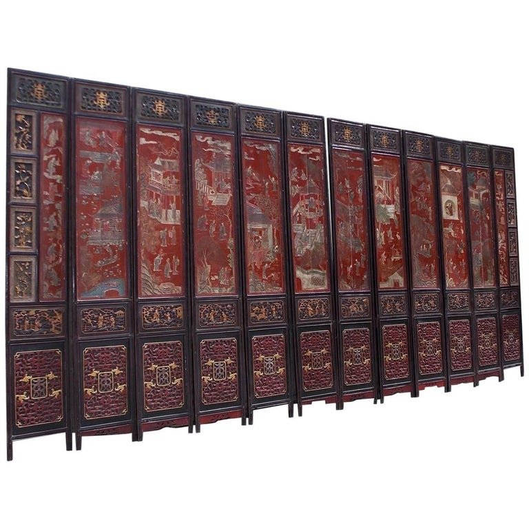 Chinese Coromandel Red Lacquer Twelve Panel Figural and Landscape Screen