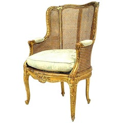French Louis XV Style '19th Century' Gilt and Caned Panel Bergere Armchair