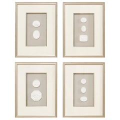 Set of Four Wall Decorations of Hand-Cast White Intaglios in Silver Leaf Frames