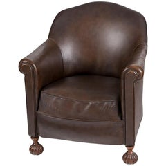 1950s English Leather Armchair with Carved Wooden Legs