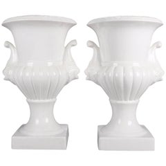 Pair of Blanc de Chine Style Porcelain Open Urns with Lion Head Handles