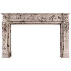 Carved French Arabescato Marble Fireplace
