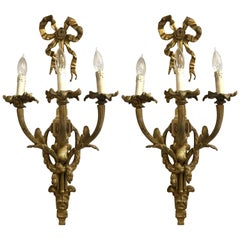 Pair of French Louis XVI Monumental Doré Bronze Three-Arm Wall Sconces
