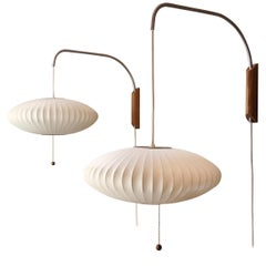 Pair of Modernica George Nelson Saucer Bubble Walnut Wall Lamps, Vintage