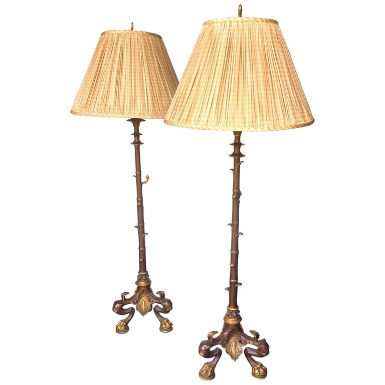 Pair of Tall Empire Style Bronze and Burnished Bronze Torchieres