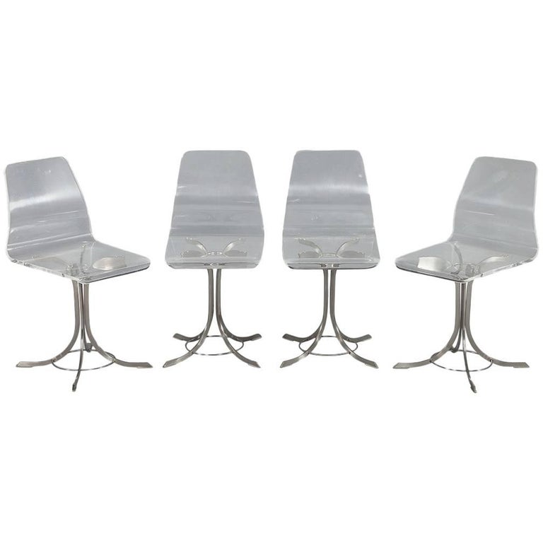Set of Four Vintage Lucite and Stainless Steel Chairs