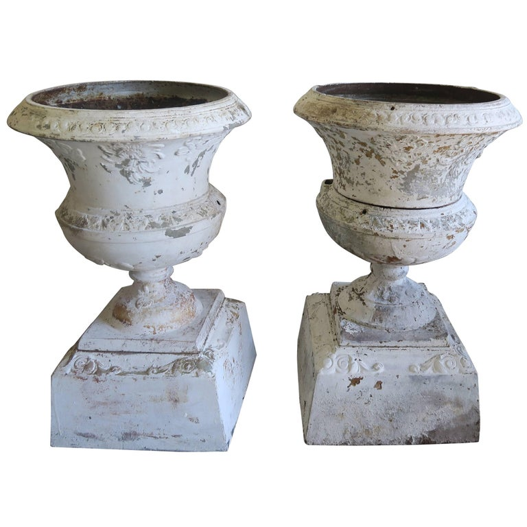 "Pair of 19th Century White Painted Cast Iron ""Chippy"" Urns"