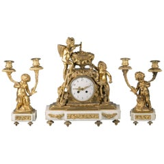 Three Piece French Bronze and Marble Clock Garniture, circa 1875