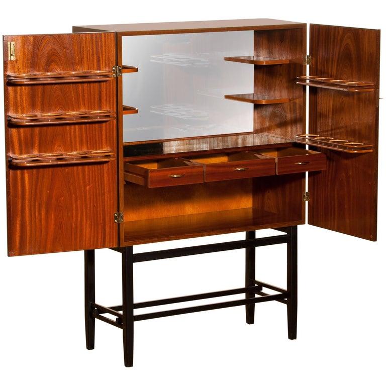 Mahogany Dry Bar Cabinet, Brass Details, High Black Skinny Legs Made by Förenade