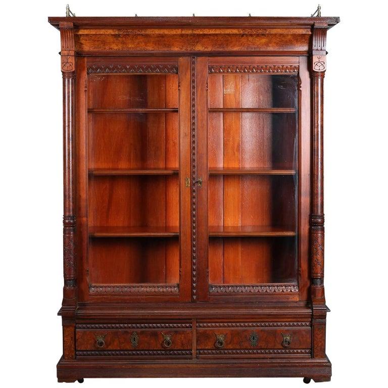 Antique Eastlake Carved And Burl Walnut Two Door Drawer Bookcase