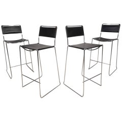 Set of Four Mid-Century Modern Leather and Chrome Bar Stools