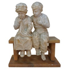 Girl and Boy Sitting on Bench Marble Sculpture