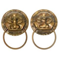 Pair of Brass Door Knockers, Prehistoric Beast