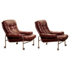 Chrome and Oxen Blood Red Leather Easy / Lounge Chairs by Scapa Rydaholm, Sweden
