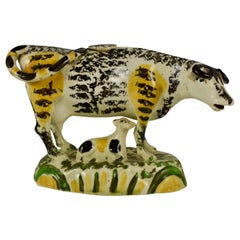 English Pottery Pratt Colored Cow Creamer with Calf, Right Facing Figure