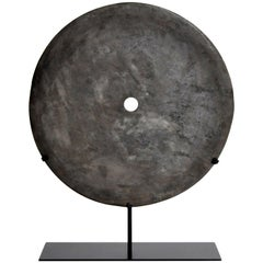 Stone Grinding Disk on Metal Stand