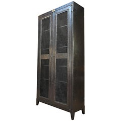 "Industrial Two Mesh Doors Iron ""Bauche"" Bookcase, circa 1950"