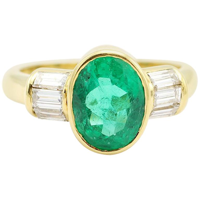 Oval Emerald and Diamond Ring, 18-Carat Yellow Gold