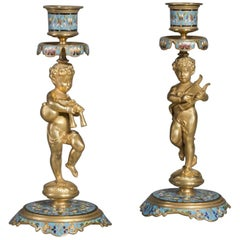 Pair of Napoléon III Champlevé  Figural Candlesticks