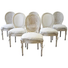 Set of Six Early 20th Century Painted Cane Back and Upholstered Dining Chairs