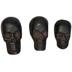 Graduated Set of Three Cast Iron Skull Opium Weights