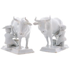 Pair of Cows with Milkers in White Dutch Delftware