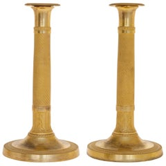 Pair of Empire Candlesticks in Gilded Bronze