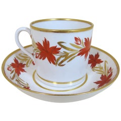 Coalport Porcelain Decorated with Red and Gilt Flowers Coffee Can and Saucer