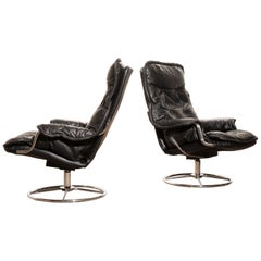 1970s, a Pair of Black Leather Swivel Chrome Steel Lounge Chairs, Sweden