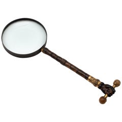 19th Century Magnifying Glass with Hand Holding a Barbell