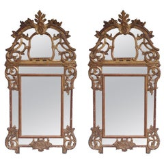 Pair of Italian Neoclassical Gilt Carved Wood Foliage Crest Mirrors, circa 1780