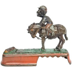 "Mechanical Bank, ""I Always Did 'Spise a Mule"" Jockey over Version, circa 1879"