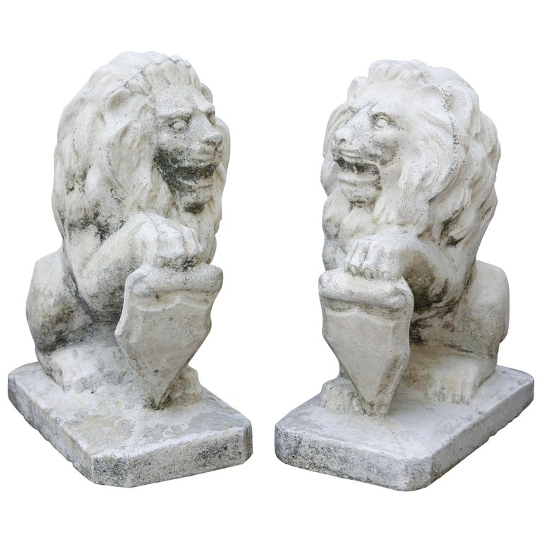 Pair of Opposing Cast Stone Lion Garden Ornaments
