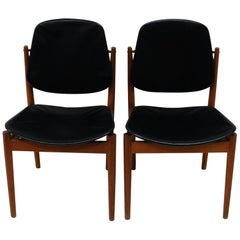Danish pair of Arne Vodder Diningchairs in teak and black leather, 1950s