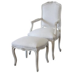 Painted French Provincial Style Chair and Ottoman Upholstered in Belgian Linen