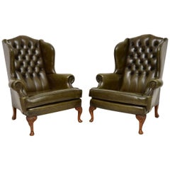 Pair of Antique Deep Buttoned Leather Wingback Armchairs