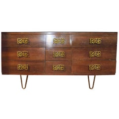 Mid-Century Modern Dresser with Large Decorative Pulls and Pin Legs