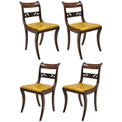 Four Mahogany Carved Plume & Acanthus Regency Style Saber Leg Dining Side Chairs