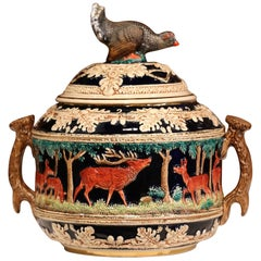 Early 20th Century French Carved Painted Ceramic Soup Tureen with Hunt Motifs