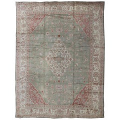 Large Antique Turkish Oushak in Green, Gray, Ivory, and Soft Coral Red
