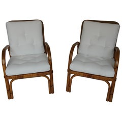 Pair of Rattan Chairs with New Upholstery