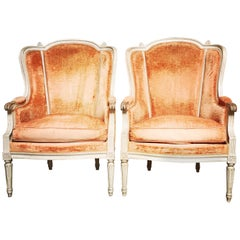 Pair of French Louis XVI Style Bergeres with a Gray Painted Finish