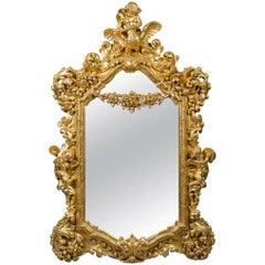 Large 19th Century Rococo Style Giltwood Carved Figural Mirror