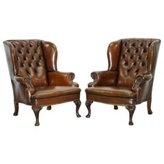Pair of Restored Cigar Brown Leather Chesterfield Wingback Armchairs Carved Legs