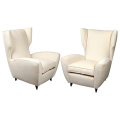 Pair of High Backs Italian Armchairs with Strikingly Modern Lines