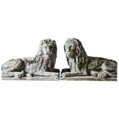 Pair of Composite Stone Recumbent Lions