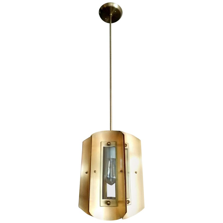 Pair of 1950s brass and glass chandeliers after Max Ingrand.